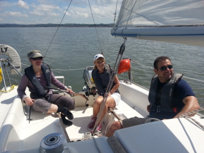 Guys and girls on a beginners yacht sailing course on the sea
